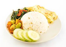 Nasi Lemak. The unofficial national dish of Malaysia namely rice cooked in coconut milk served with eggs, sambal and in this picture kangkong (water convolvulus Royalty Free Stock Photos