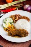 Nasi Lemak. Ayam Rendang with sambal belacan royalty free stock image