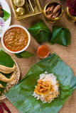 Nasi lemak bungkus, a traditional malay curry paste rice dish se. Rved on a banana leaf photo royalty free stock photography