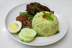 Nasi Lemak is the famous traditional malay local food in Malaysia. Nasi Lemak is one of the famous traditional malay local food in Malaysia royalty free stock image
