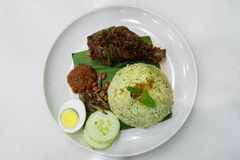 Nasi Lemak is the famous traditional malay local food in Malaysia. Nasi Lemak is one of the famous traditional malay local food in Malaysia stock photo