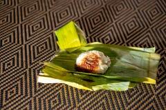 Nasi-lemak ist ein malaysisches wohlriechendes Reisgericht, das in der Kokosmilch und im pandan oder Bananenblatt gekocht wird lizenzfreie stockbilder