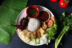 Nasi lemak kukus with quail meat top view, malaysian local food. In restaurant royalty free stock photos