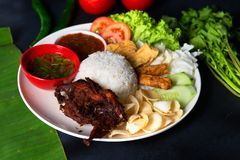 Nasi lemak kukus with quail meat top view, malaysian local food. In restaurant royalty free stock images