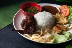 Nasi lemak kukus with quail meat top view, malaysian local food. In restaurant stock image