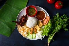 Nasi lemak kukus with quail meat top view, malaysian local food. In restaurant stock photo