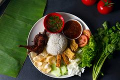 Nasi lemak kukus with quail meat top view, malaysian local food. In restaurant royalty free stock photography