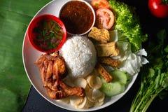 Nasi lemak kukus with thigh malaysian local food. Top down royalty free stock photo