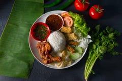 Nasi lemak kukus with thigh malaysian local food top down. In restaurant royalty free stock photos