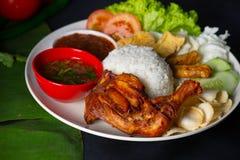 Nasi lemak kukus with thigh malaysian local food top down. Restaurant stock photography
