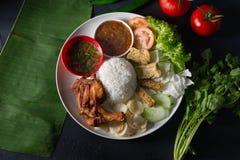 Nasi lemak kukus top view, malaysian local food. In restaurant stock image