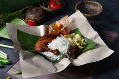 Nasi lemak kukus traditional malay dish. In restaurant royalty free stock photos