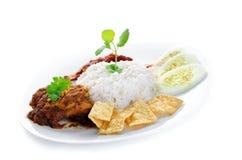 Nasi lemak kukus. Nasi lemak traditional malaysia spicy rice dish. Served with belacan, ikan bilis, acar, peanuts and cucumber. Malaysian food. Asian cuisine royalty free stock photos