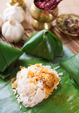 Nasi lemak Malay dish. Popular traditional Malaysian food wrapped with banana leaf royalty free stock images