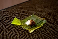 Nasi lemak is a Malay fragrant rice dish cooked in coconut milk and pandan or banana leaf. It is common food found in Malaysia Royalty Free Stock Image