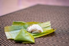 Nasi lemak is a Malay fragrant rice dish cooked in coconut milk and pandan or banana leaf. It is common food found in Malaysia Royalty Free Stock Images