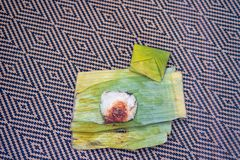 Nasi lemak is a Malay fragrant rice dish cooked in coconut milk and pandan or banana leaf. It is common food found in Malaysia Royalty Free Stock Photos