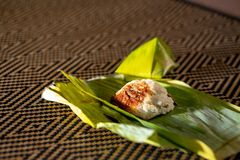 Nasi lemak is a Malay fragrant rice dish cooked in coconut milk and pandan or banana leaf. It is common food found in Malaysia Royalty Free Stock Photo