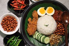 Malaysia food nasi lemak. Nasi lemak is a Malay fragrant rice dish cooked in coconut milk and pandan leaf. It is commonly found in Malaysia royalty free stock images