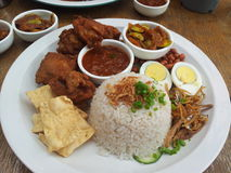 Nasi lemak. Malaysian style coconut rice serve with fried chicken, egg, chili paste Stock Photos