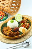 Nasi Lemak. A Malaysian traditional coconut milk steam rice Royalty Free Stock Photography