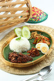 Nasi Lemak. A Malaysian traditional coconut milk steam rice Stock Images