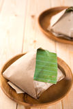 Nasi Lemak packed in banana leaf Stock Images