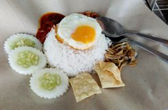 Nasi lemak serve with fried egg stock photo