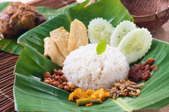 Nasi lemak, a traditional malay curry paste rice dish served on. A banana leaf photo stock images