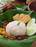 Nasi lemak, a traditional malay curry paste rice dish served on. A banana leaf food royalty free stock photo