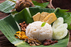 Nasi lemak, a traditional malay curry paste rice dish served on. A banana leaf photo royalty free stock image