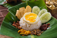 Nasi lemak, a traditional malay curry paste rice dish served on. A banana leaf photo stock photos