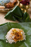 Nasi lemak, a traditional malay curry paste rice dish served on Stock Photos