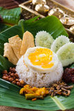 Nasi lemak, a traditional malay curry paste rice dish served on. A banana leaf food royalty free stock photos