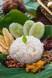 Nasi lemak, a traditional malay curry paste rice dish served on. A banana leaf photo stock image
