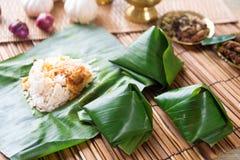Nasi lemak wrapped with banana leaf. royalty free stock image