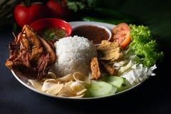 Nasi lemakkukus, malaysian lokal mat royaltyfria foton