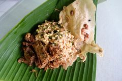Nasi pecel from Madiun, East Java, Indonesia. Nasi pecel is a Javanese rice dish served with mix vegetables and peanut sauce Royalty Free Stock Photo