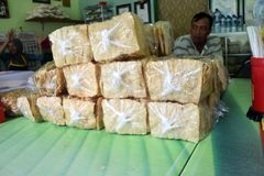 Nasi pecel from Madiun, East Java, Indonesia. A man waiting to eat rice pecel in a small restaurant Madiun, East Java, Indonesia on February 12, 2016 Stock Photo