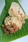 Nasi pecel from Madiun, East Java, Indonesia. Nasi pecel is a Javanese rice dish served with mix vegetables and peanut sauce Royalty Free Stock Images