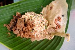 Nasi pecel from Madiun, East Java, Indonesia. Nasi pecel is a Javanese rice dish served with mix vegetables and peanut sauce Stock Images
