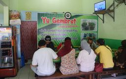 Nasi pecel from Madiun, East Java, Indonesia. People waiting to eat rice pecel in a small restaurant Madiun, East Java, Indonesia on February 12, 2016 Royalty Free Stock Photos