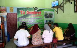 Nasi pecel from Madiun, East Java, Indonesia. People waiting to eat rice pecel in a small restaurant Madiun, East Java, Indonesia on February 12, 2016 Stock Image