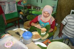 Nasi pecel from Madiun, East Java, Indonesia. A woman selling pecel rice selling her wares to her customers who are waiting in madiun, east java, indonesia Stock Photos