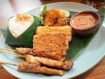 Nasi uduk with chicken satay , indonesian dish. Nasi uduk is indonesian spicy dish royalty free stock photography