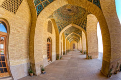 Nasir al-Mulk Mosque arcade fisheye. Fisheye view of the arcade hall passages of the Nasir al-Mulk Mosque is a traditional mosque located in Goad-e-Araban place Royalty Free Stock Photo