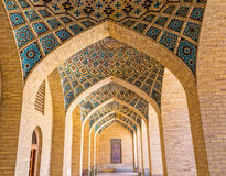 Nasir al-Mulk Mosque arcade hall. Arcade hall passages of the Nasir al-Mulk Mosque is a traditional mosque located in Goad-e-Araban place in Shiraz Royalty Free Stock Photos