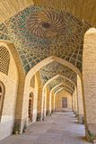 Nasir al-Mulk Mosque arcade hall vertical. Arcade hall passages of the Nasir al-Mulk Mosque is a traditional mosque located in Goad-e-Araban place in Shiraz Royalty Free Stock Image