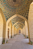 Nasir al-Mulk Mosque arcade hall vertical. Arcade hall passages of the Nasir al-Mulk Mosque is a traditional mosque located in Goad-e-Araban place in Shiraz Stock Images