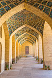 Nasir al-Mulk Mosque arcade hall vertical. Arcade hall passages of the Nasir al-Mulk Mosque is a traditional mosque located in Goad-e-Araban place in Shiraz Stock Photography